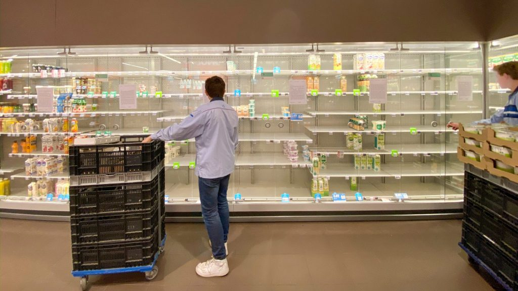 Empty supermarket shelves due to stockpiling because of Corona Virus